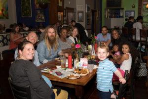 Happy group enjoying dinner