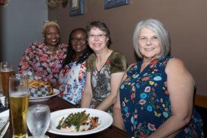 Happy ladies enjoying a meal