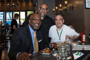 Happy men enjoying a meal